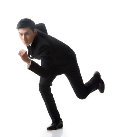 businessman jumping: Attractive young business man running, full length portrait isolated on white background.