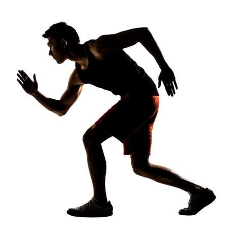 Silhouette of young Asian athlete running, full length portrait isolated on white. photo