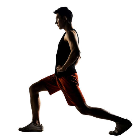 lunges: Asian man exercising fitness workout lunges crouching in silhouette on white background