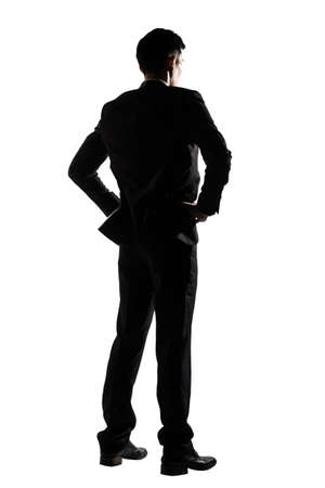 Silhouette of business man standing, full length portrait isolated on white background. photo