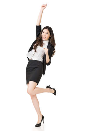 Excited Asian business woman, full length portrait isolated on white background. photo