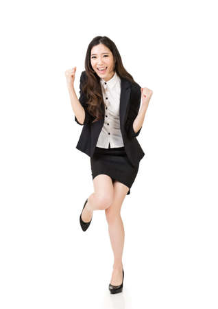 Excited Asian business woman, full length portrait isolated on white background. Stock Photo