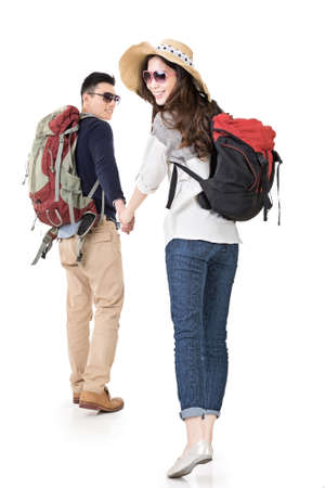 chinese people: Asian young traveling couple, man holding womans hand and lead her go to somewhere, full length portrait isolated on white background. Stock Photo