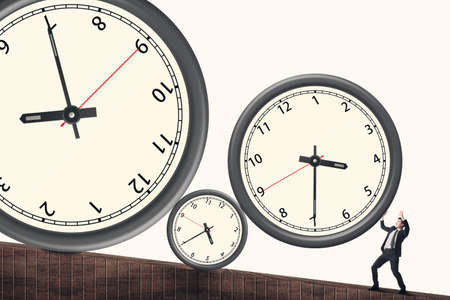 resist: Time pressure concept, Asian business man face the rolling clock. Stock Photo