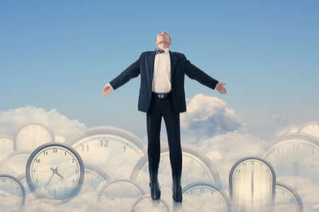 Asian businessman fly over clocks, concept of time management, success, free etc.