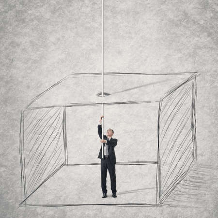 Concept of businessman escape from a box .  photo