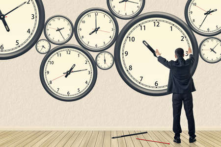Asian business repair the clock, concept of time management, rebuild, busy etc. Stock Photo
