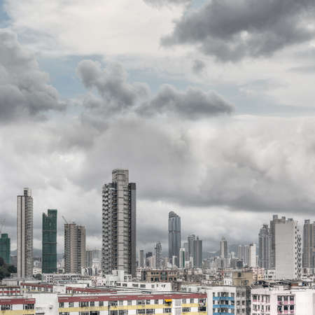 Typical Hong Kong apartment skyline, new, old and under construction buildings located in the same area. Picture shot at Sham Shui Po district, Hong Kong, Asia. photo