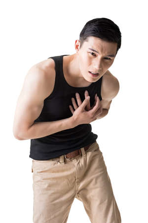 heart pain: Asian young man with heart pain, close up portrait.