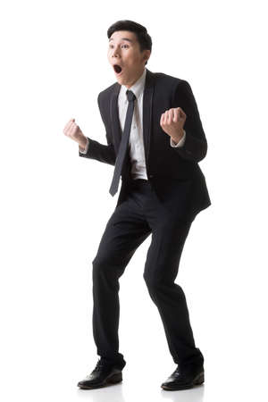 Surprise: Asian business surprised with outrageously and funny pose, full length portrait isolated on white background.