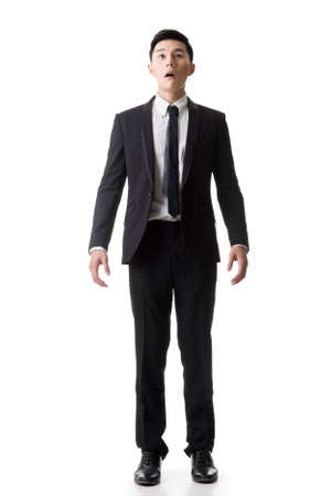 Asian business surprised with outrageously and funny pose, full length portrait isolated on white background. photo