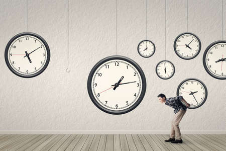 back in time: Put back the clock to the right position, concept of time management, plan, efficient etc.  Stock Photo