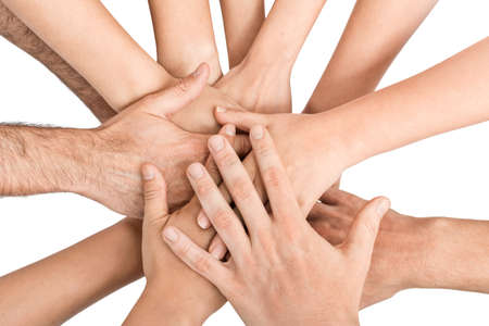 Group of hands holding together on white background. photo