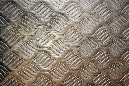 Background of metal diamond plate in grungy color. photo