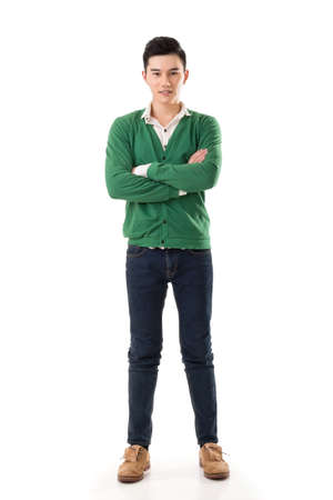 Attractive young Asian man, full length portrait isolated on white background. photo