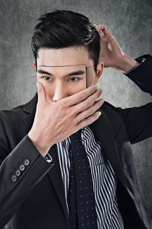 Asian business man in mask, concept of hide, cheat, lie etc. photo
