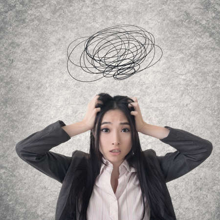 disorder: Confused Asian business woman. Photo compilation with hand drawn background.