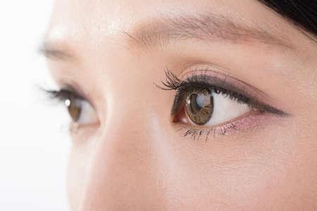 eyebrow  look: Asian woman eyes, closeup image.