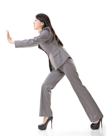 slack: Full length portrait of Asian business woman push, side view isolated on white background.