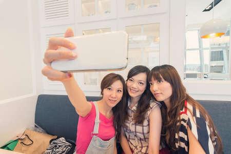 Happy smiling Asian women selfie in a restaurant. photo