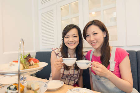 Afternoon tea time with friends in restaurant.