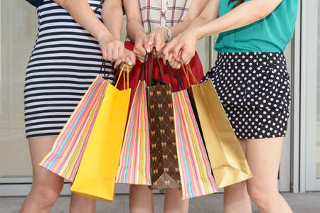 Group of Asian women shopping and holding shopping bags. photo