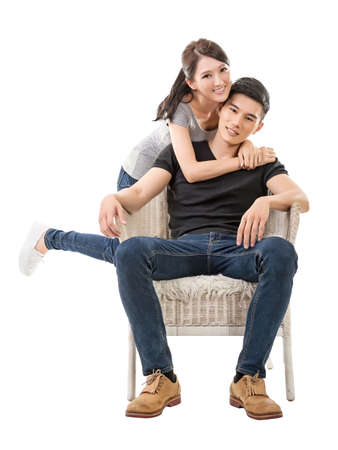 Attractive young Asian couple, full length portrait isolated on white. photo