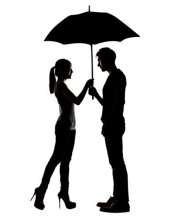 Silhouette of Asian couple holding umbrella, full length portrait isolated on white.