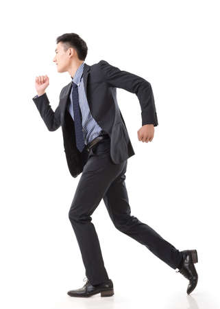 Attractive young business man running, full length portrait isolated on white background. photo