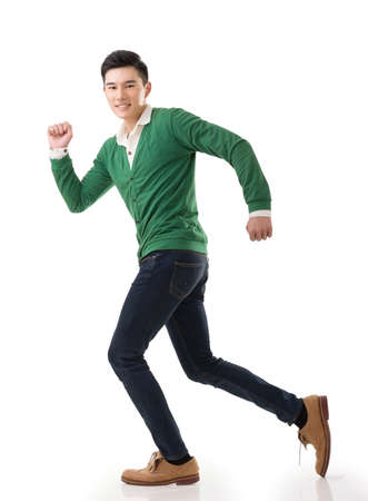 Asian young man running, full length portrait isolated on white. photo