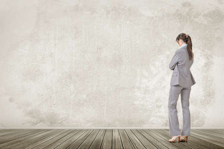 contemplative: One business executive lowered head and contemplate, rear view of full length portrait.