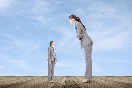 Asian businesswoman looking on her big version on the roof. Business growth concept. photo