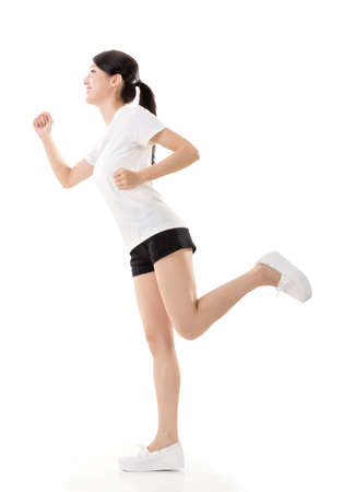 Attractive Asian woman running, full length portrait isolated on white background. photo