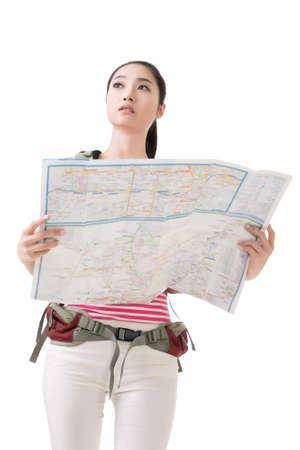 tourist guide: Asian traveler woman holding a map, full length portrait isolated on white.