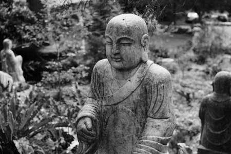 bodhisattva: Ruined stone statue Ksitigarbha Bodhisattva in garden.