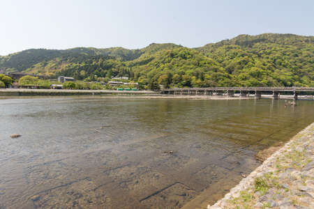 From a distance and crossing the river on Togetsukyo Bridge of Arashiyama photo