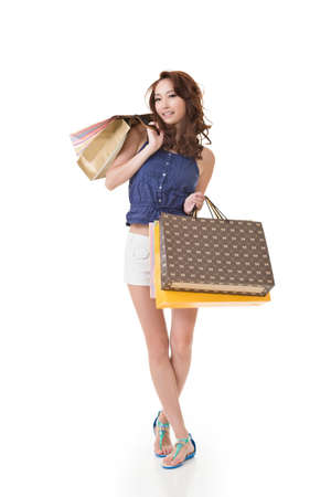 asian shopper: Attractive Asian woman shopping and holding bags, full length portrait isolated on white background. Stock Photo