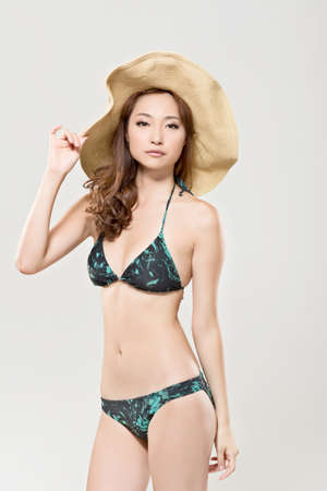 korean fashion: Attractive sexy asian lady in bikini with hat. Stock Photo