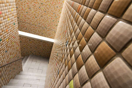 Mosaic texture wall with stairs. photo