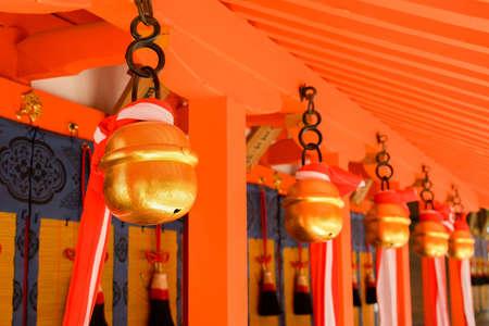Japanese temple bells in Fushimi Inari Taisha Shrine, Kyoto, Japan