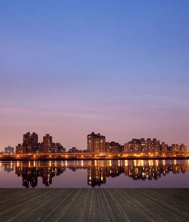 colourful sky: City night scene with wooden ground.