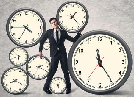 symbol victim: Time pressure concept, Asian business man with many clocks.