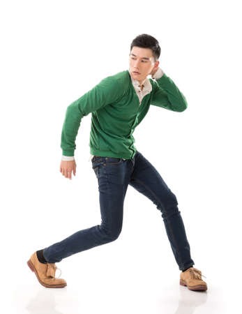 korean man: Asian guy with dramatic pose, full length portrait isolated on white background. Stock Photo