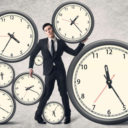 Time pressure concept, Asian business man with many clocks. photo