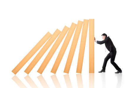 Business concept of stop the domino effect. photo