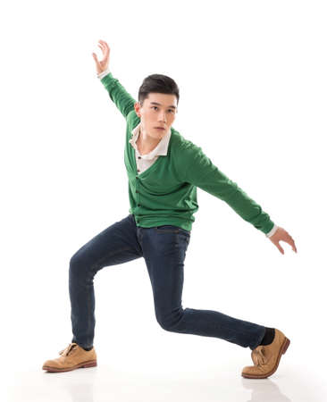 outraged: Asian guy with dramatic pose, full length portrait isolated on white background. Stock Photo