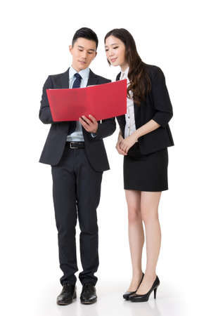 Asian business man and woman discussing, full length portrait isolated on white background. photo