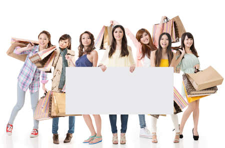 chinese people: Attractive Asian woman shopping and one lady holding blank board, full length portrait isolated on white background.