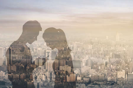 Couple reflection on window glass in sunset city, concept of couple, connection, relationship etc.