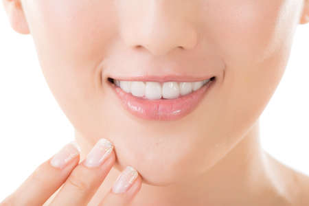Asian smiley face with white teeth, closeup portrait. photo